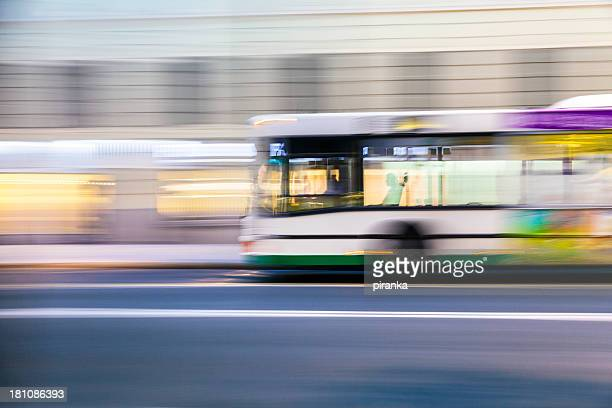 bus driving on city street - moving past stock pictures, royalty-free photos & images