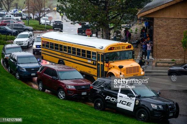 A bus evacuating students arrives at the Recreation Center at Northridge after at least seven students were injured during a shooting at STEM School...