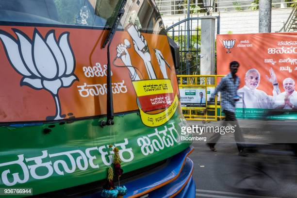 A bus featuring campaign advertisements for the Bharatiya Janata Party is displayed outside the party's office in Bengaluru Karnataka India on...