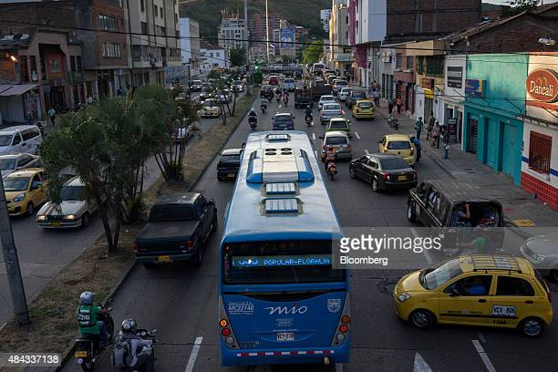 A bus from the Masivo Integrado de Occidente public transportation system travels down a street in Cali Colombia on Wednesday Aug 12 2015 Colombia's...