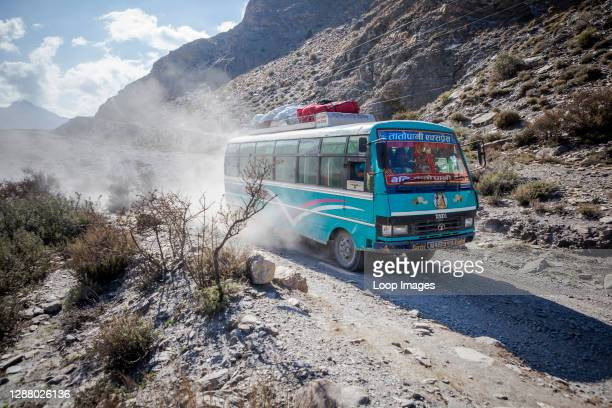 Bus heading up the dusty road from the Kali Gandaki.