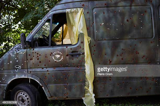 A bus hit by shrapnel sits on the base of the Luhansk chapter of the Night Wolves motorcyle club who fight on the side of selfproclaimed Lugansk...