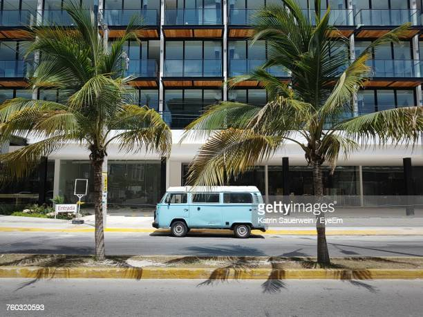 bus in front of buildings in city - abandoned car stock photos and pictures