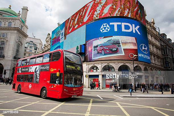 bus in picadilly circus - piccadilly stock pictures, royalty-free photos & images