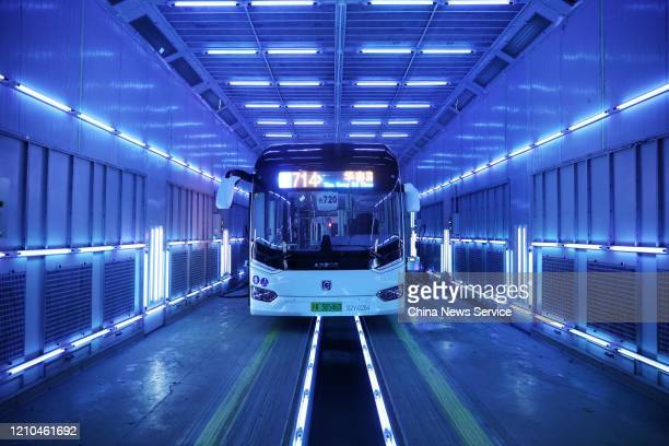 A bus is being disinfected by ultraviolet light on March 4 2020 in Shanghai China According to the latest guideline on the diagnosis and treatment of...