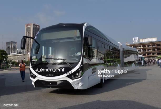 A bus is drives at the southern sation of the SOTRA in Abidjan on December 13 as the Ivorian Transport Minister delivered a speech for the...