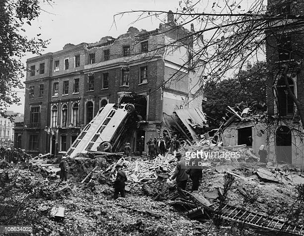 A bus is left leaning against the side of a terrace in Harrington Square Mornington Crescent in the aftermath of a German bombing raid on London in...