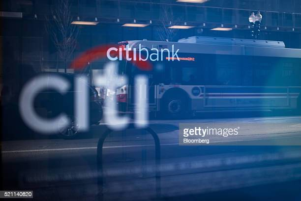 A bus is reflected in a Citigroup Inc Citibank branch window in Chicago Illinois US on Monday April 11 2016 Citigroup Inc is scheduled to release...