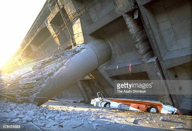 A bus is squashed as the Hanshin Expressway elevated highway collapses after the strong earthquak on Janaury 17 1995 in Kobe Hyogo Japan Magnitude 73...