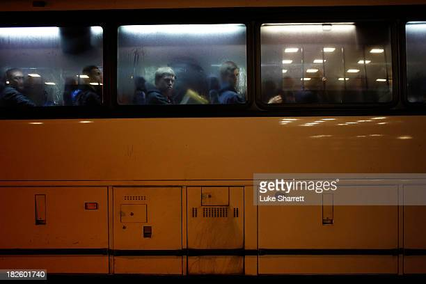 A bus load of new recruits from OÕHare International Airport arrives at Navy Basic Training on the evening of April 8 2013 in Great Lakes Illinois...