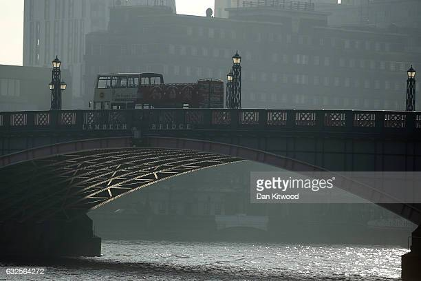 A bus makes it's way through haze over Lambeth Bridge on January 24 2017 in London England The Mayor of London Sadiq Khan has announced that a toxic...