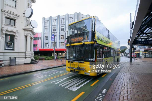 Bus makes its way through quiet streets during the first day of a national lockdown on August 18, 2021 in Wellington, New Zealand. Level 4 lockdown...