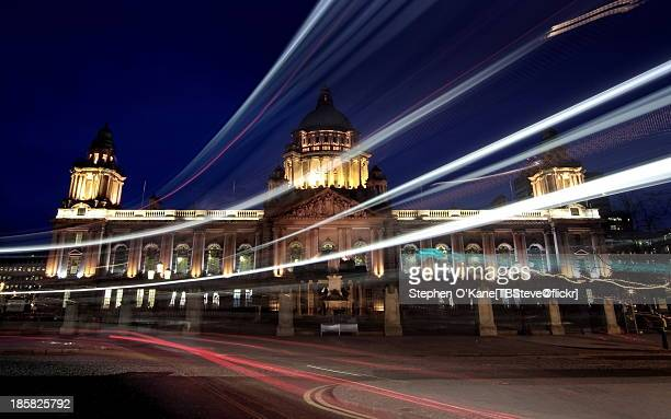 bus night light trails at belfast city hall - belfast stock pictures, royalty-free photos & images