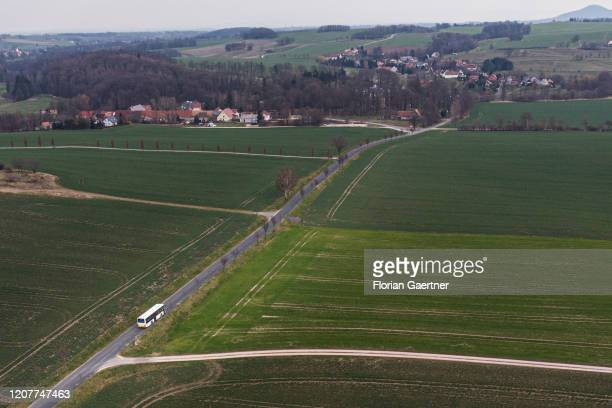 A bus on a country road is pictured between two villages on March 19 2020 in Kodersdorf Germany