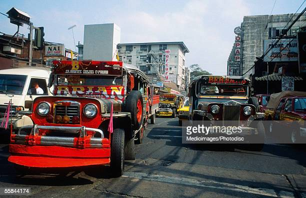 bus on a crowded street, manila, philippines - manila philippines stock pictures, royalty-free photos & images