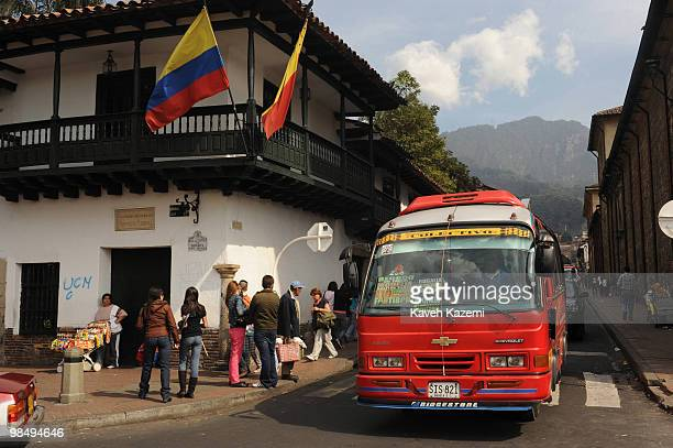 A bus on the corner of Bolivar square in the old part of the city Bogota formerly called Santa Fe de Bogota is the capital city of Colombia as well...