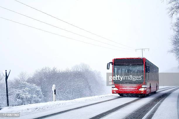 Bus on winter road, heavy snowfall
