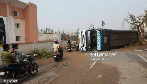 A bus overturned on the road seen after Cyclone Fani on May 4 2019 in Puri India At least 12 people are reported to have died and more than a...