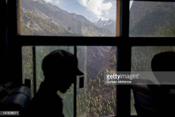 Bus passenger silhouette against mountain scenery