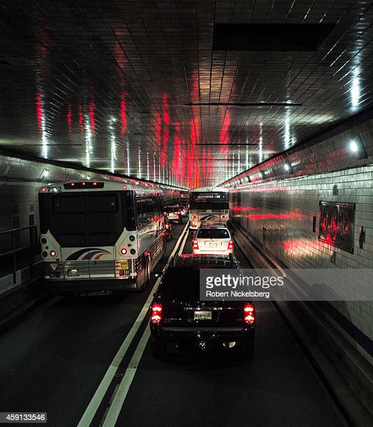 Bus passengers on board a Megabus coach service are caught in traffic November 10 2014 in the Lincoln Tunnel in Weehawken New Jersey
