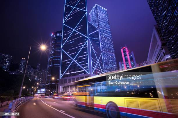 Bus passing illuminated Central District of Hong Kong