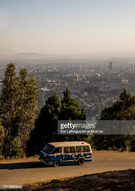 Bus passing in front of a panoramic view of the town seen from Entoto mountain Addis Ababa Region Addis Ababa Ethiopia on December 1 2019 in Addis...