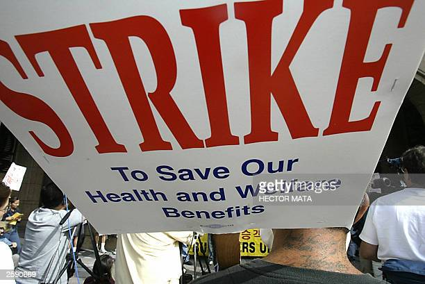 Bus Riders Union members hold signs as they demonstrate against the Metropolitan Transportation Authority Board of Directors in Los Angeles CA 14...