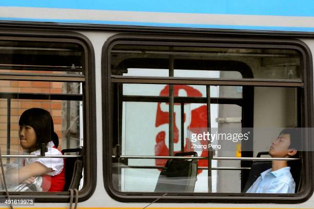 A bus rides past a Beijing 2008 Olympics logo