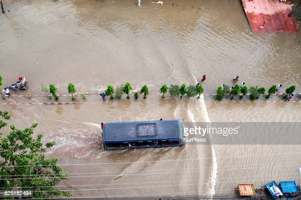 Bus run middle in the water at water logging area July 26 2017 Chittagong Bangladesh Every day the Chittagong city is facing unmatched waterlogging...