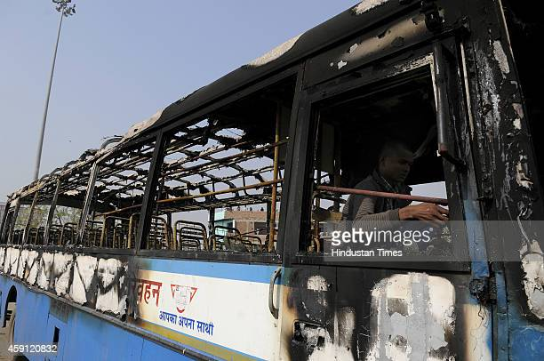 Bus set ablaze by angry mob after their houses were demolished in anti-encroachment drive by Greater Noida Authority at Kulsera village on November...