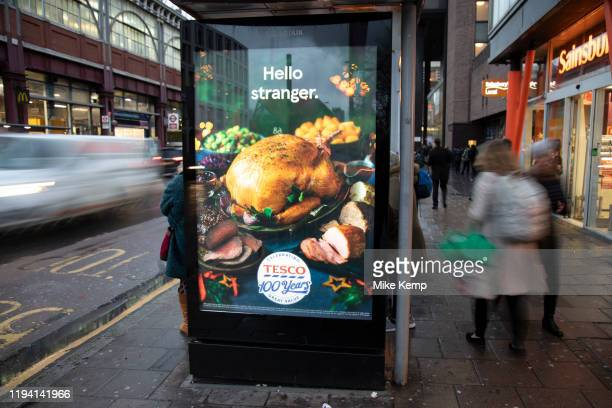 Bus shelter advert for Tesco Christmas turkey on 27th November 2019 in London England United Kingdom Christmas dinner is a traditional meal usually...