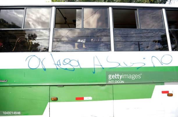 A bus shows a graffiti reading Ortega Killer during a protest against Nicaraguan President Daniel Ortega's government in Managua on september 29 2018...