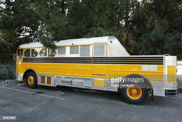 A bus sits in front of the house March 13 2004 in Fresno California According to reports nine bodies were found entwined in piles of clothing in a...