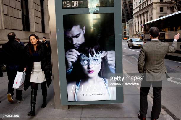 A bus station advertises a new movie along 5th Avenue on February 8 2017 in New York City The area around Trump Tower in midtown Manhattan is filled...