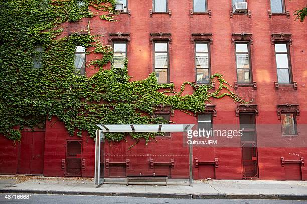 Bus stop and red brick building, New York City, USA