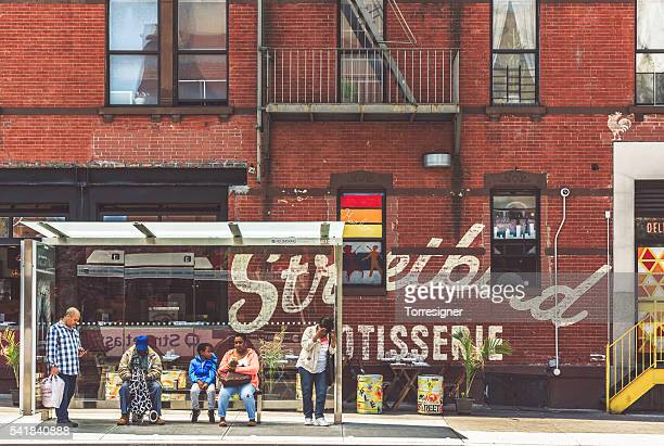 bus stop at harlem, next to the streetbird rotisserie - harlem stock pictures, royalty-free photos & images