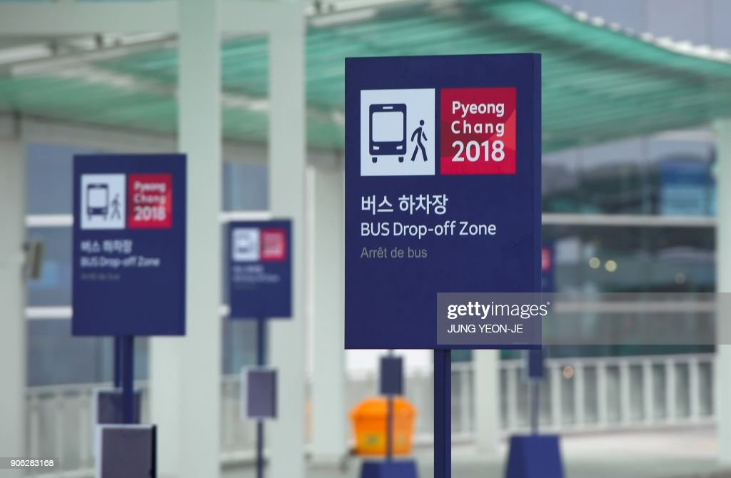 Bus stop signs for the 2018 PyeongChang Winter Olympics are seen at Terminal 2 of Incheon International Airport, west of Seoul, on January 18, 2018. Incheon airport, South Korea's top gateway, on January 18 opened its second terminal, three weeks before the opening of the Pyeongchang Olympics, airport authorities said. Terminal 2 houses four airlines -- South Korea's flag carrier Korean Air, Air France, Delta, and KLM Royal Dutch Airlines.