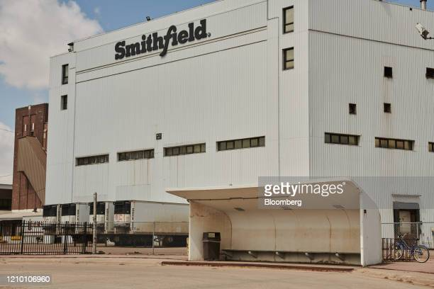 A bus stop stands empty in front of the closed Smithfield Foods Inc plant in Sioux Falls South Dakota US on Wednesday April 15 2020 South Dakota...
