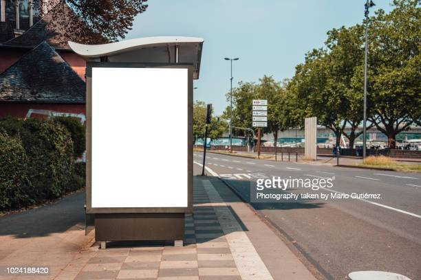 bus stop with billboard - vertical stock pictures, royalty-free photos & images