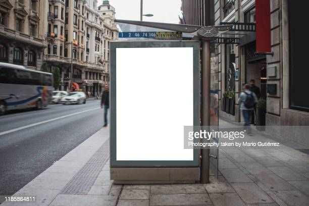bus stop with billboard - madrid stock pictures, royalty-free photos & images