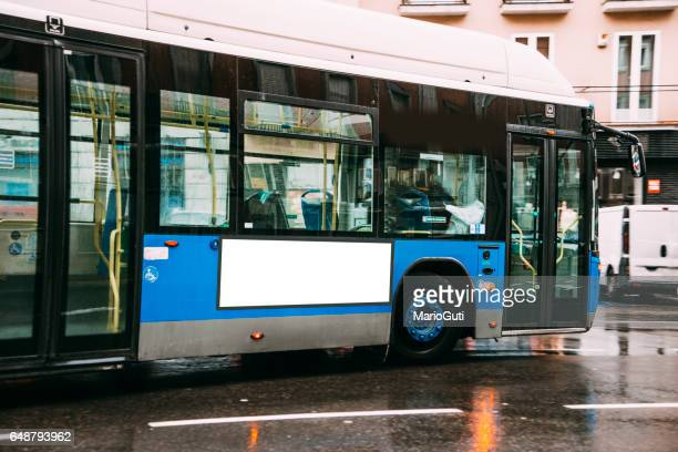 bus stop with blank billboard - bus stock photos and pictures
