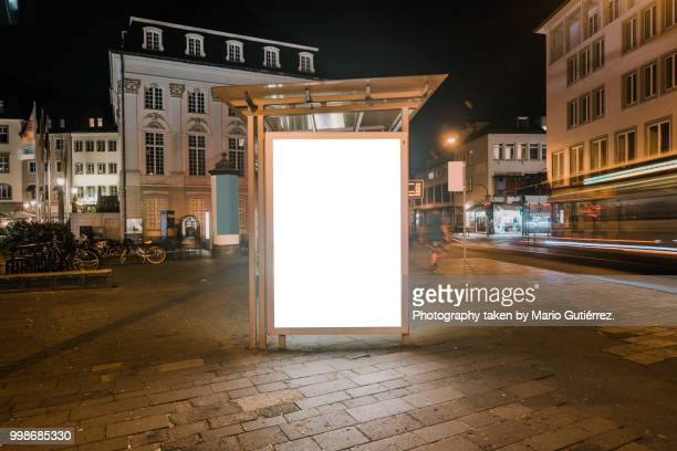 bus stop with blank billboard - zakenman stock pictures, royalty-free photos & images