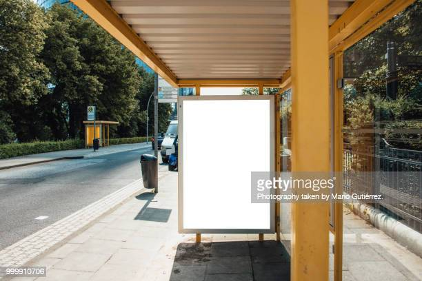 Bus stop with blank billboard