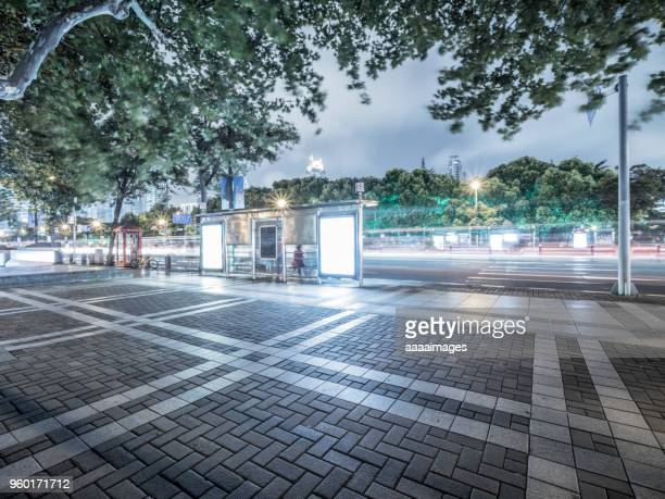 bus stop with blank billboards at night