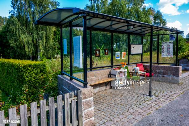 Bus stop with furniture, books and pictures