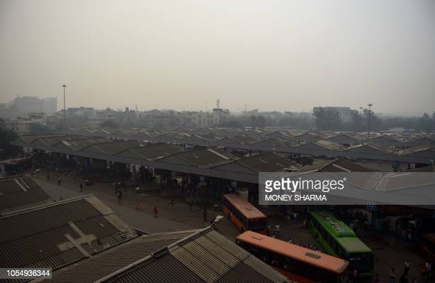 A bus terminal is pictured amid heavy smog conditions in New Delhi on October 29 2018 Smog levels spike during winter in Delhi when air quality often...