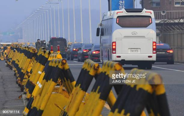 A bus transporting a South Korean delegation for interKorea workinglevel talks passes a military checkpoint leading to the border truce village of...