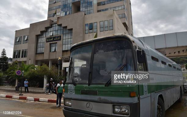 Bus transporting jailed Algerian journalist Khaled Drareni is pictured at the entrance of a court in Algiers, on September 8, 2020. - An Algerian...