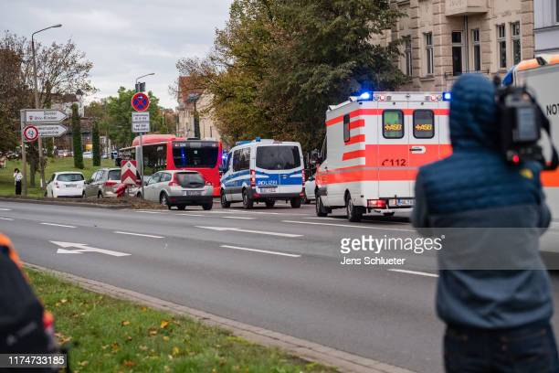 A bus transports rescued parishioners of the Jewish community near the scene of a shooting that has left two people dead on October 9 2019 in Halle...
