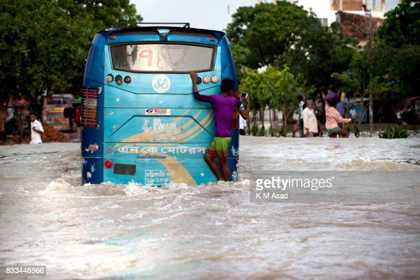 AGRABAD DHAKA CHITTAGONG BANGLADESH A bus traveling through a flooded area of Chittagong People traveling in flooded areas in Chittagong Chittagong...